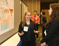 Student at a poster with a judge