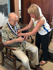 Placing the medal on Gordon Moore
