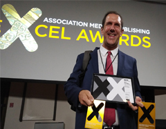 Robert Frederick accepts EXCEL awards